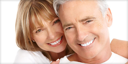 A smiling couple happy after visit to Attar Dental at Libertyville IL
